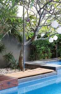 Pool shower on wooden base